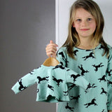 girl's unicorn long sleeve sweater top with back pleat. Newborn baby and girl's sizes.