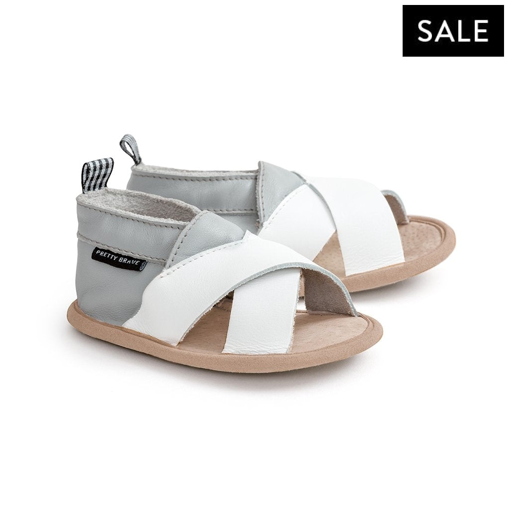 grey white criss cross sandal pair Pretty Brave baby shoes