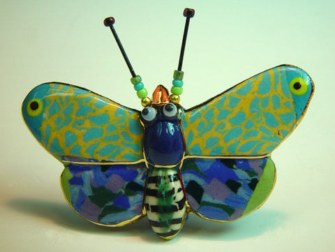 Molly Moth porcelain and mixed media pin