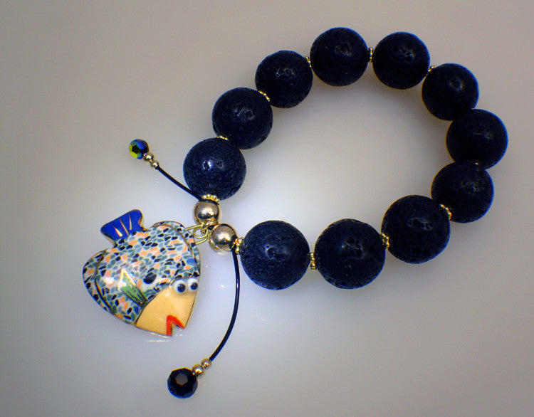 Lava stone bracelet with fish charm of porcelain