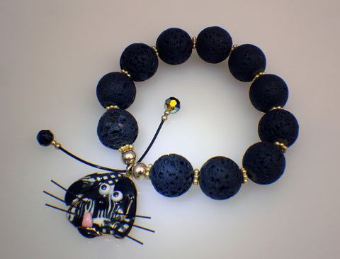 Lava stone bracelet with dog charm of porcelain