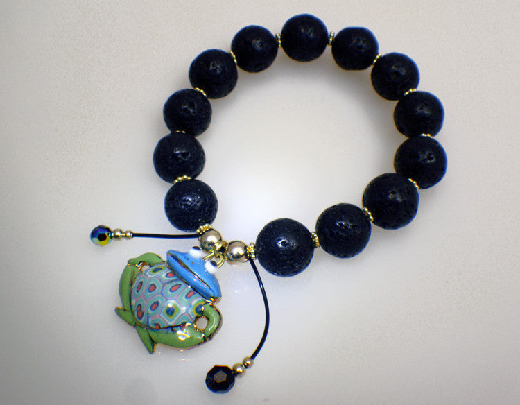 Lava stone bracelet with frog charm of porcelain