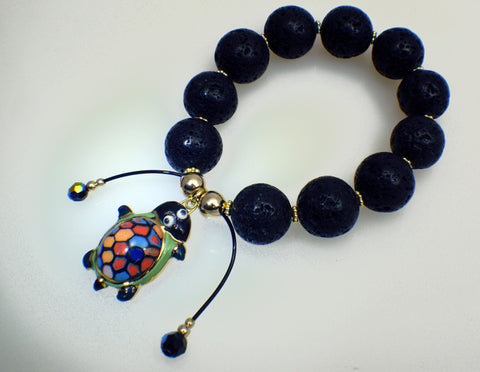 Lava stone bracelet with turtle charm of porcelain