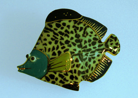 Black-spotted fish porcelain and mixed media pin