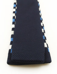 Back view of blue, black and white knit tie
