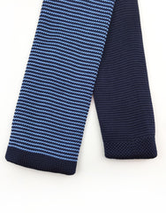 tip of blue pinstriped knitted tie