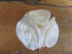 white flower suit pin