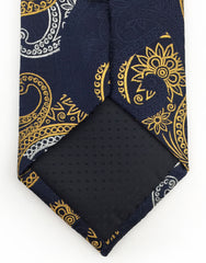 Navy gold tip of tie