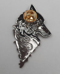 back of silver wolf pin
