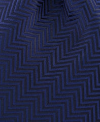 black herringbone tie close up
