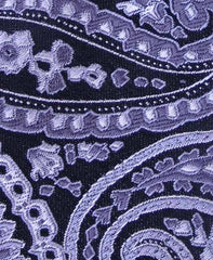 silver and black floral tie close up