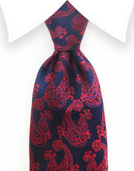 raspberry red paisley tie on navy and black background