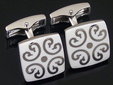 White cufflinks with silver design