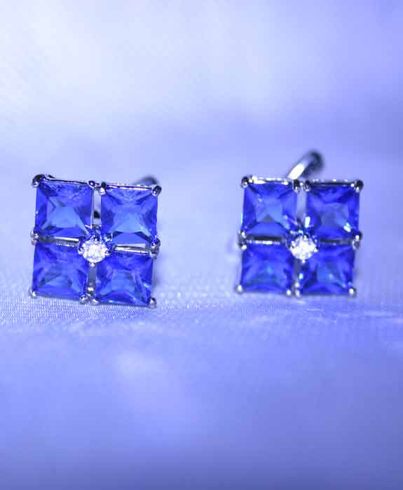 Blue crystal flower cufflinks in plated silver setting