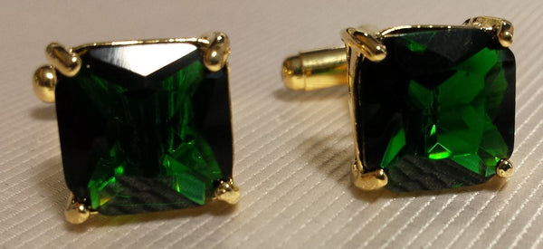gold cufflinks with green stone
