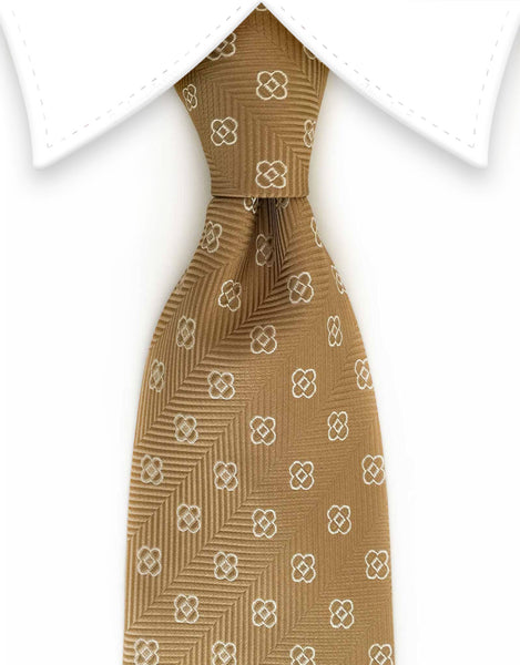 gold tie with white flower motif