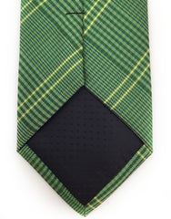 tip of green plaid tie