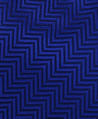 blue herringbone tie close up