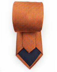 tip of orange herringbone necktie
