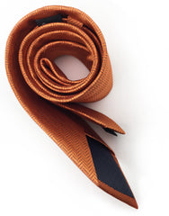 rolled up orange herringbone ties