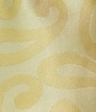 Soft yellow paisley tie close up