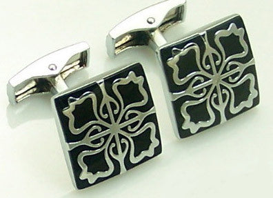 Black cufflinks with silver design