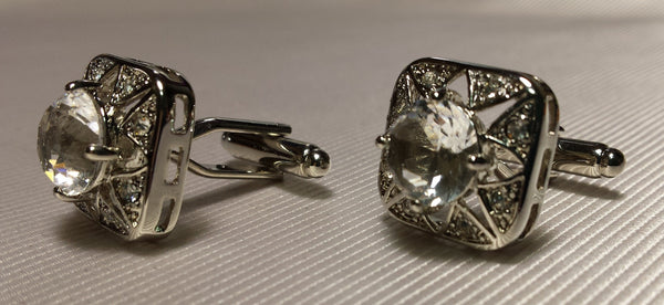 Clear crystal set in silver cufflinks
