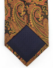 tip of orange paisley tie