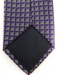 Tip of purple and silver tie