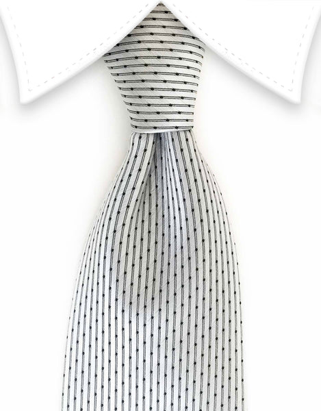 Silver tie with vertical stripes and black dots