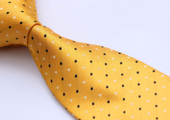 yellow tie with black white dots