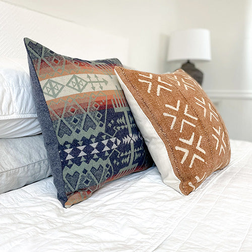 Handmade decorative pillows on a bed