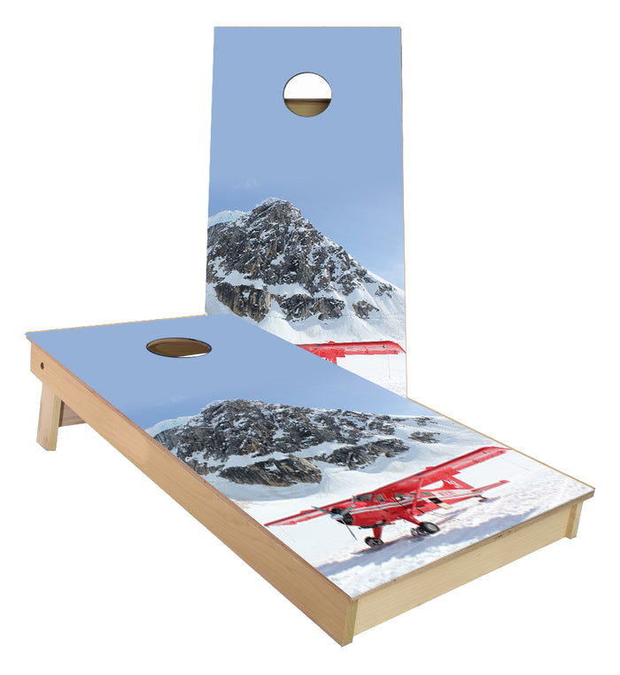Airplane on the side of a mountain in the snow cornhole boards