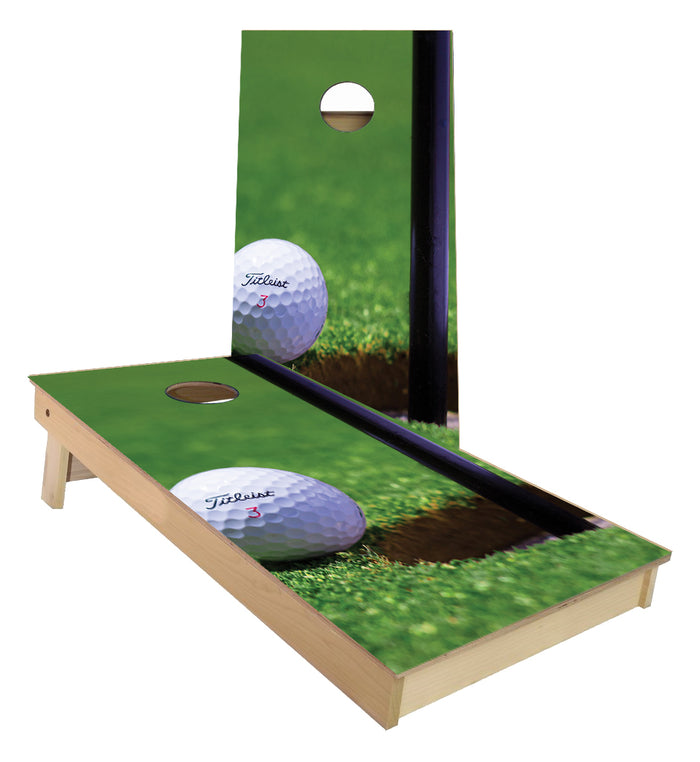 Golf Ball next to Flag Cornhole Boards