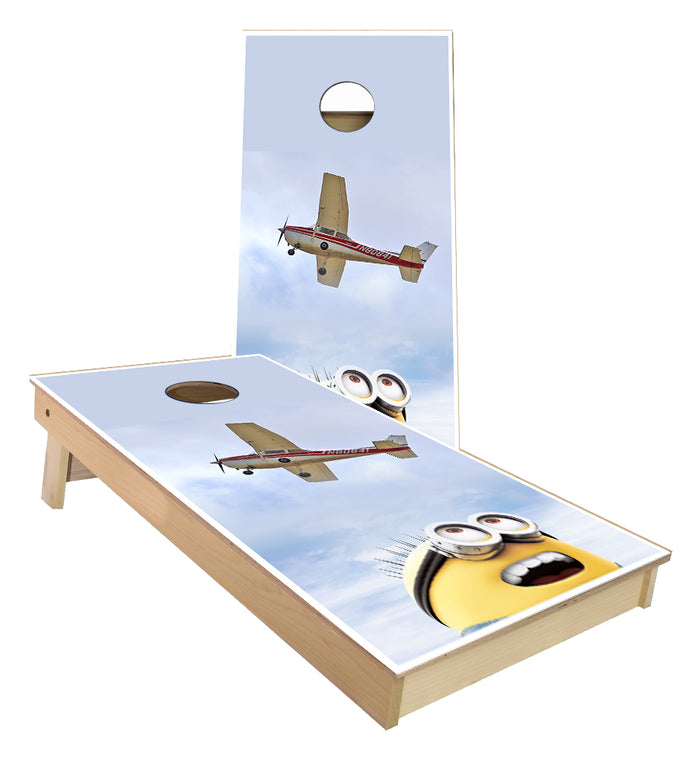 Minions watching airplane fly Cornhole Boards
