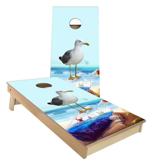 Sea Gull Standing on Glass bottle of Ocean View Sailboats cornhole boards
