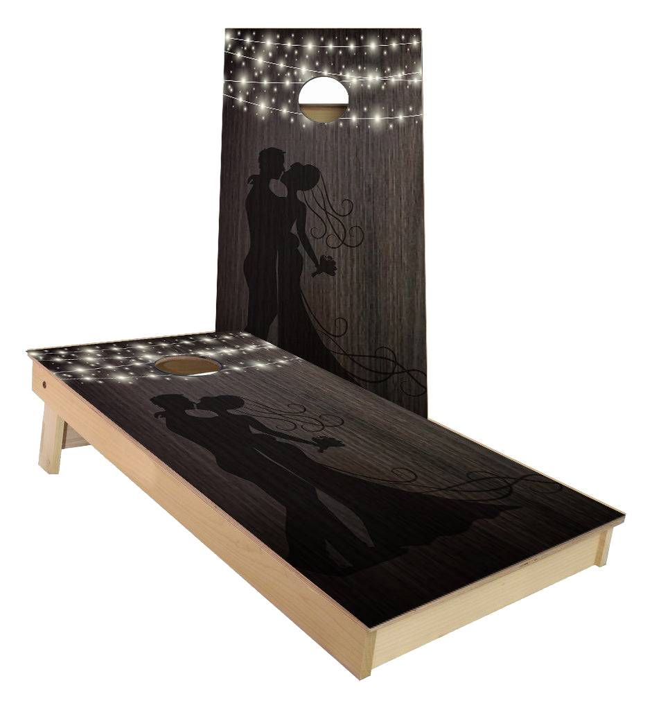 Husband and Wife Silhoutte string lights cornhole boards