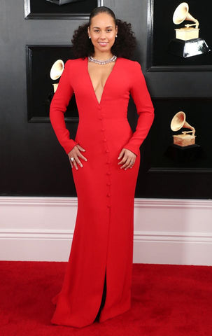 Alicia Keyes on Grammy red carpet wearing a long red dress with plunging neckline