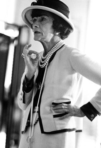 photo of coco chanel wearing white suit