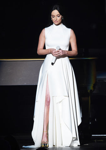 Kacey Musgraves at the Grammy Awards wearing a long white dress