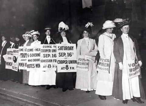 female suffragettes wearing white to a protest in the 1900's