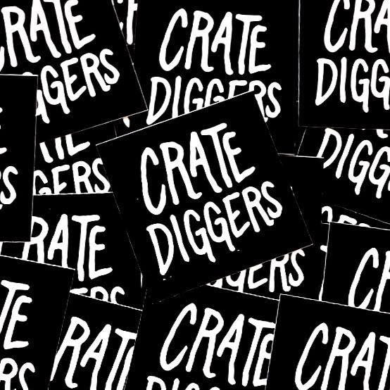 Overlapping black Crate Diggers stickers