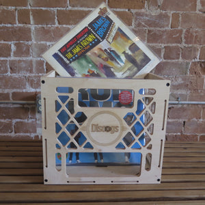 Discogs branded record crate holding stack of vinyl records