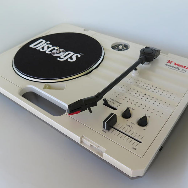 "Discogs branded 7"" slipmat on portable turntable"