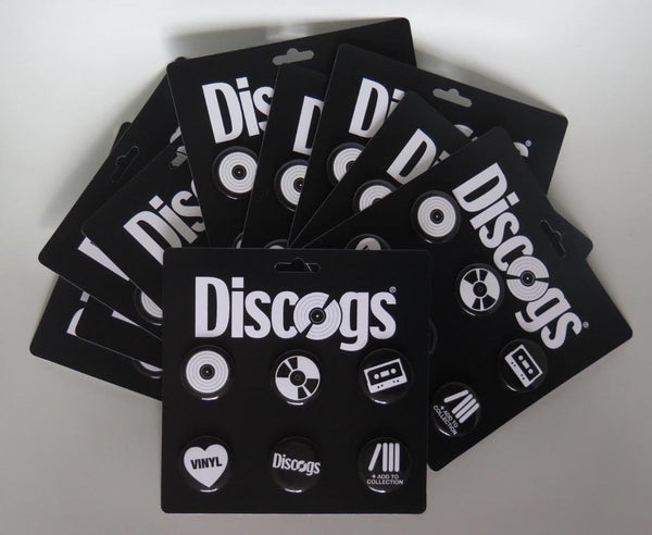Several packages of Discogs branded pins for sale