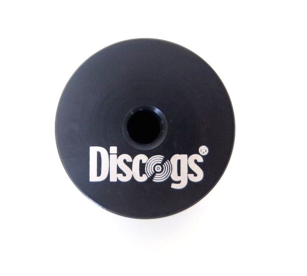 "Underside of a black aluminium 45"" record adapter with Discogs logo"