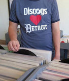 Person wearing 'Discogs Loves Detroit' t-shirts digs through record crates