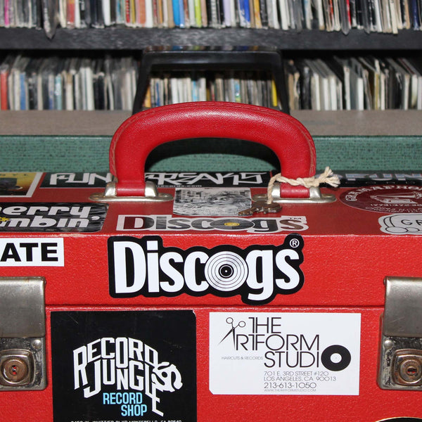 Discogs sticker on record carry case