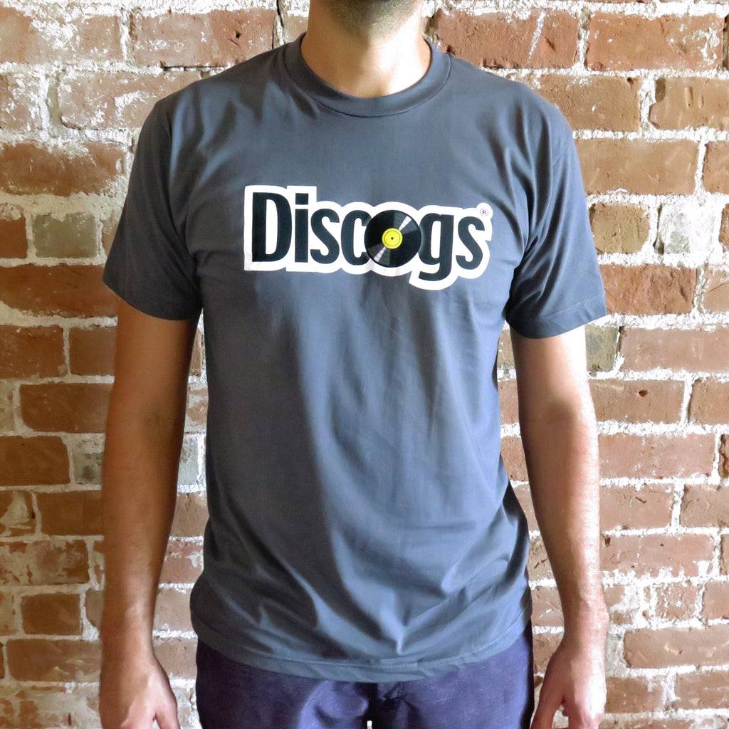 Model wears Discogs t-shirt with throwback style logo