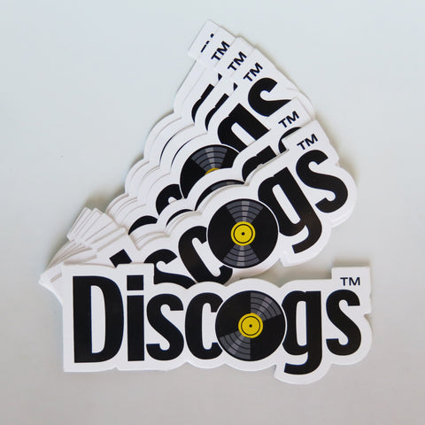 Stack of throwback style Discogs stickers with yellow record label